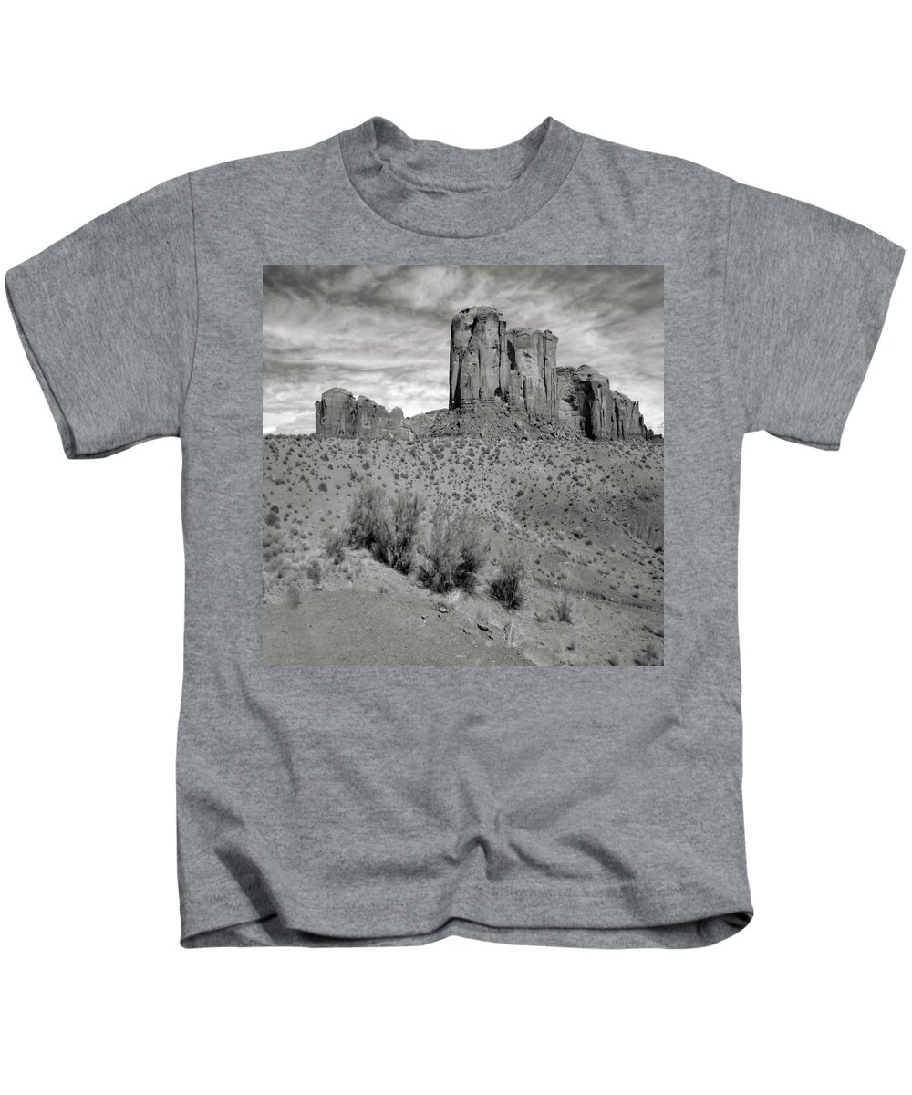 Arizona; Utah: United States; Usa; Southwest; Clouds; America; American; Beauty; Black; Deep; Desert; Environment; Erosion; Formation; Geology; Grand; Kids T-Shirt featuring the photograph Monumentvalley 33 by Ingrid Smith-Johnsen