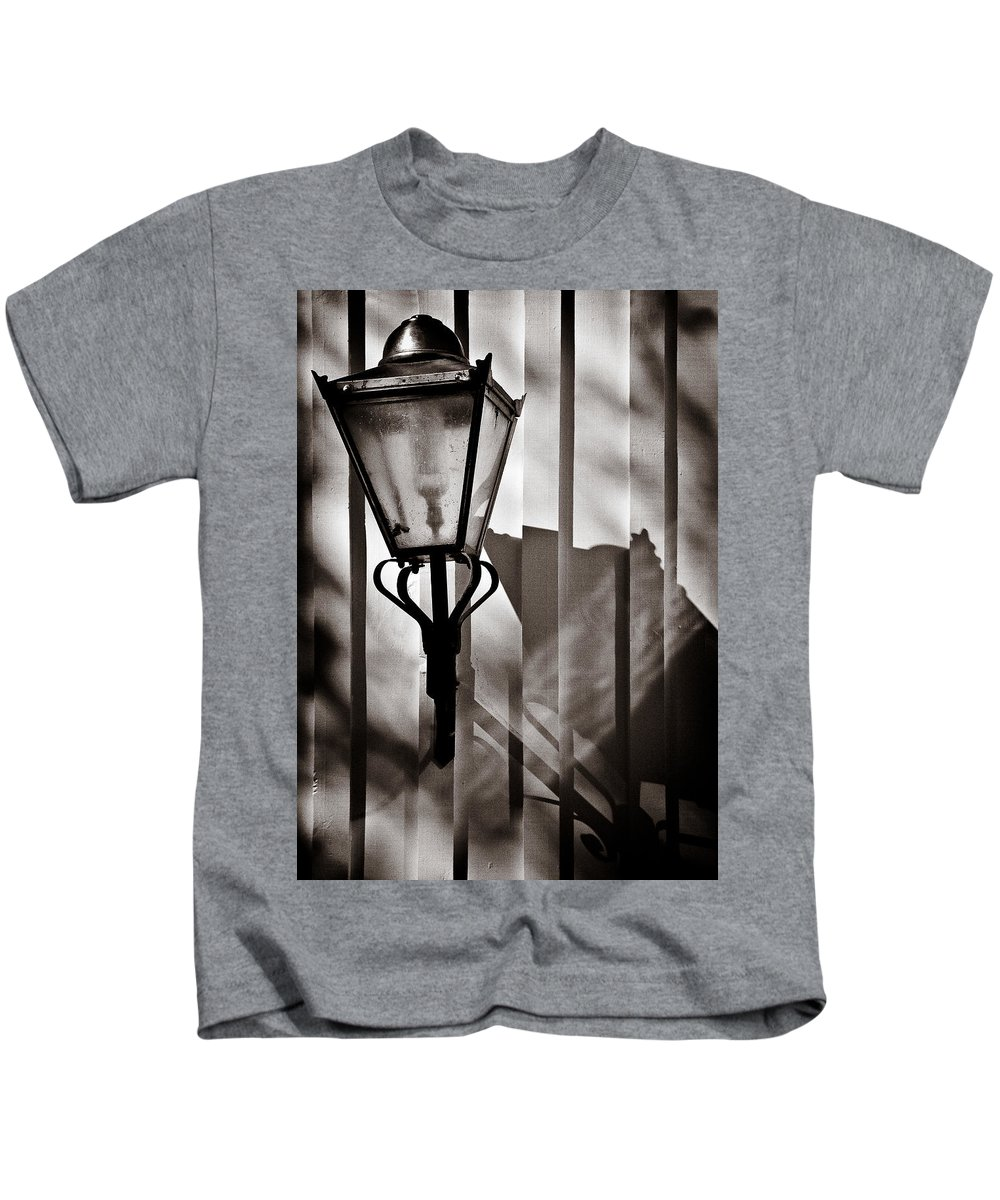 Moth Kids T-Shirt featuring the photograph Moth And Lamp by Dave Bowman