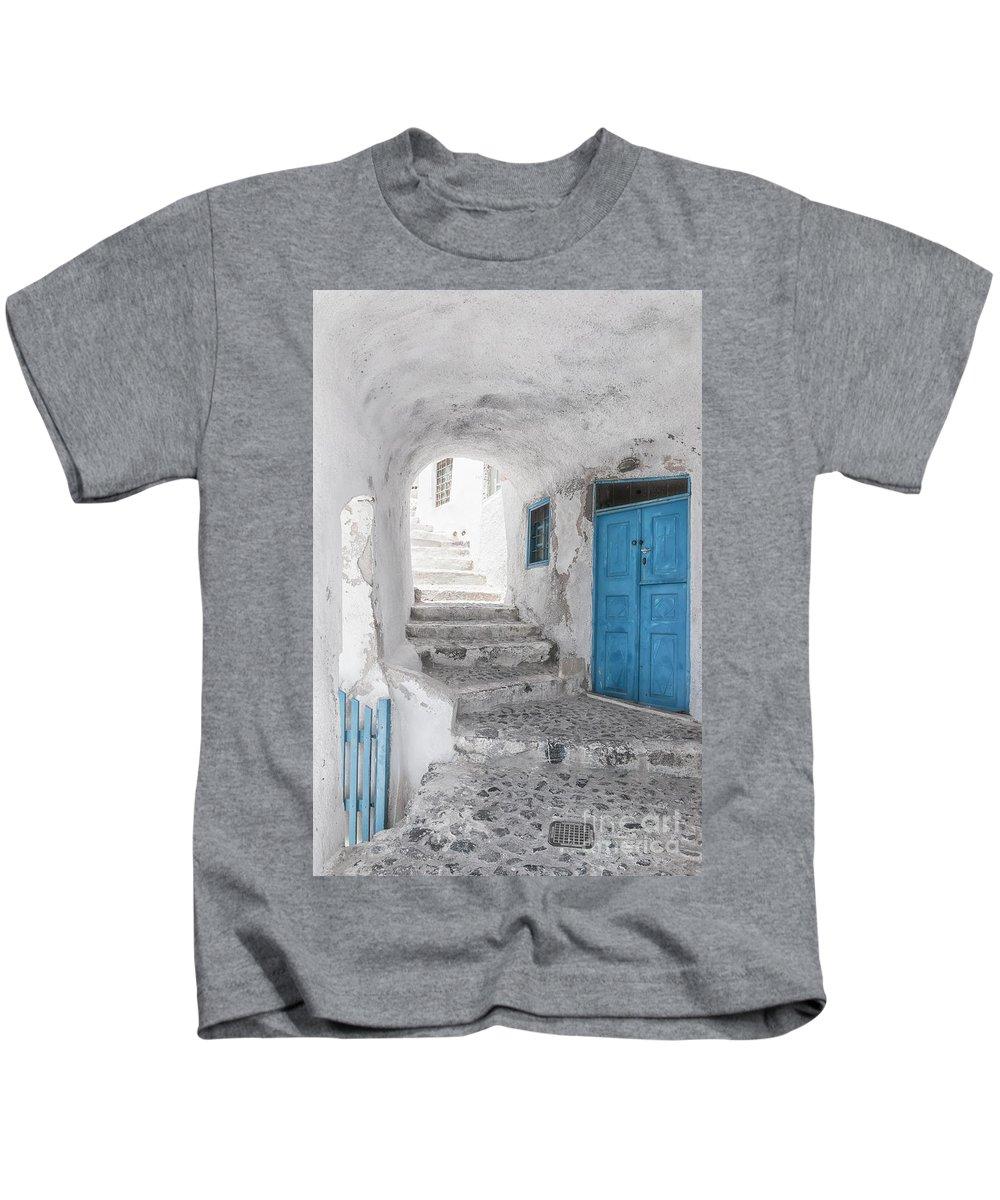 Santorini Kids T-Shirt featuring the photograph Narrow Alley And Stairway On Santorini by Antony McAulay