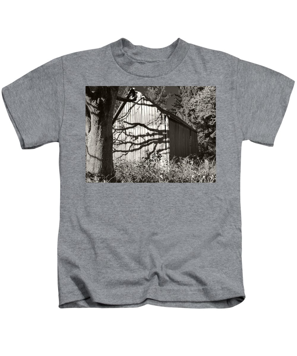 Kevin Felts Kids T-Shirt featuring the photograph Oak Shadows On A Barn by Kevin Felts