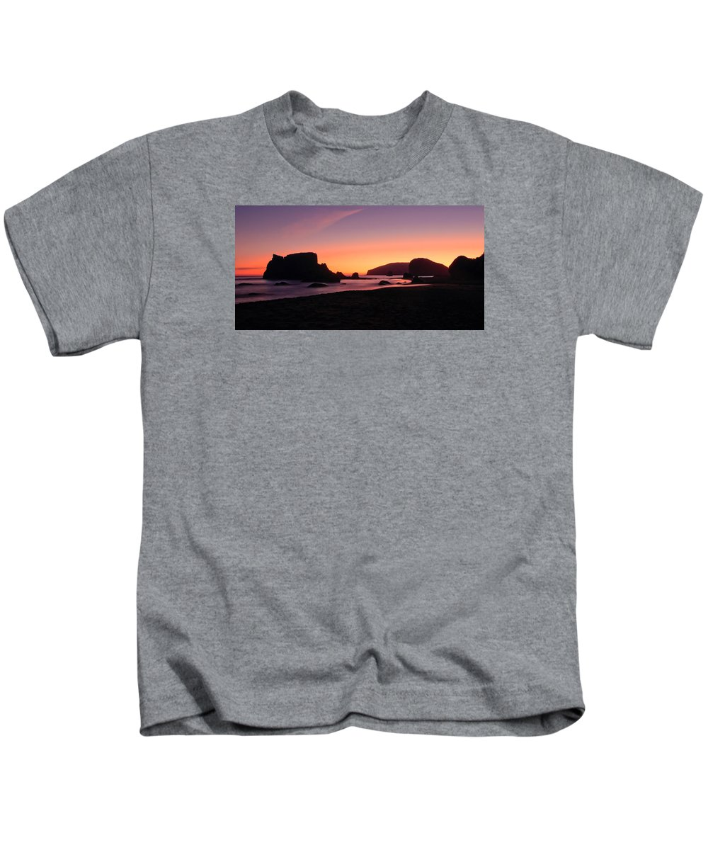 Brookings Kids T-Shirt featuring the photograph Oregon Coast Silhouette by Don Schwartz
