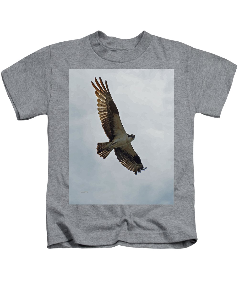 Birds Kids T-Shirt featuring the photograph Osprey In Flight by Ernie Echols