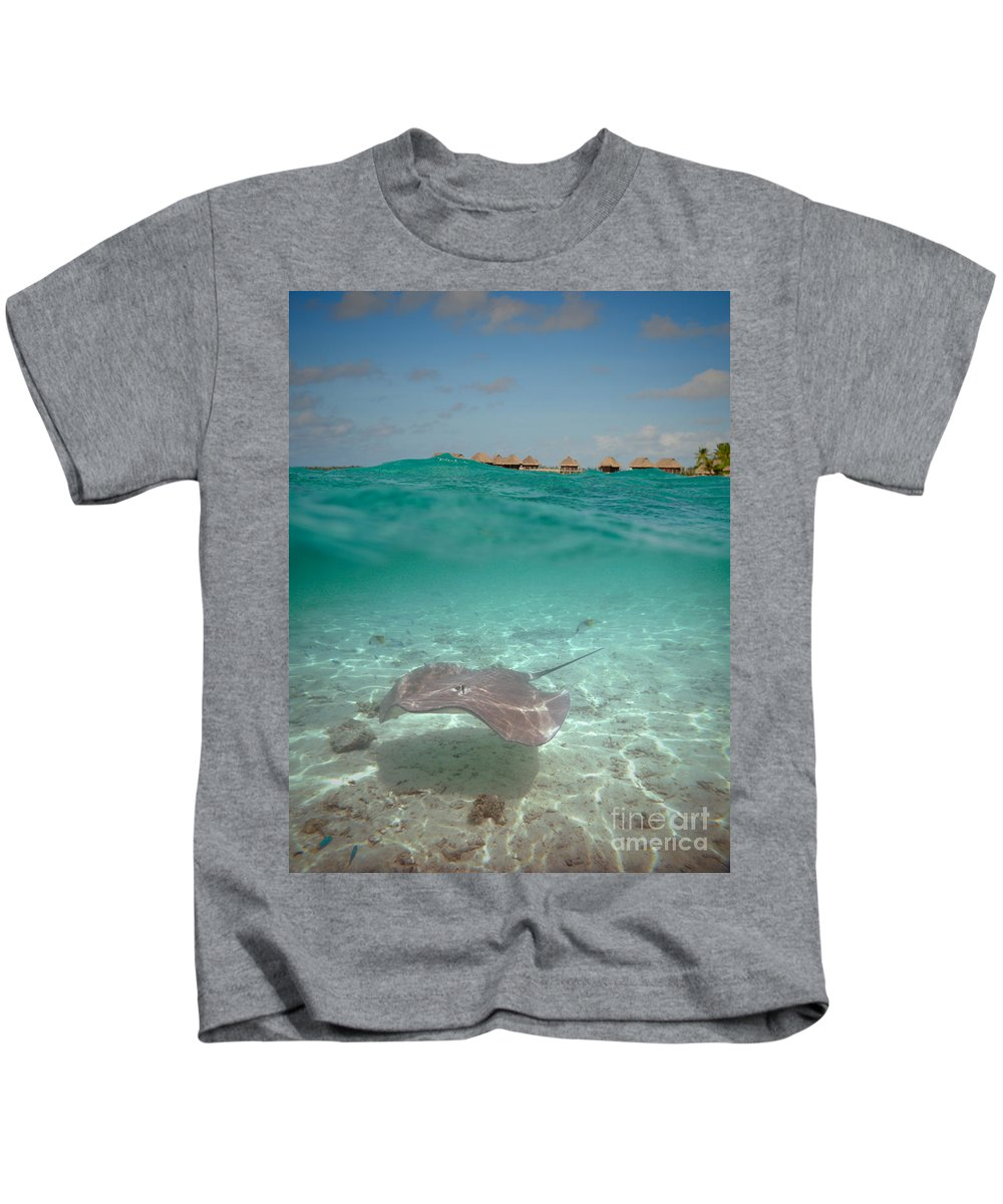 Stingray Kids T-Shirt featuring the photograph Over-under Water Of A Stingray At Bora Bora by IPics Photography