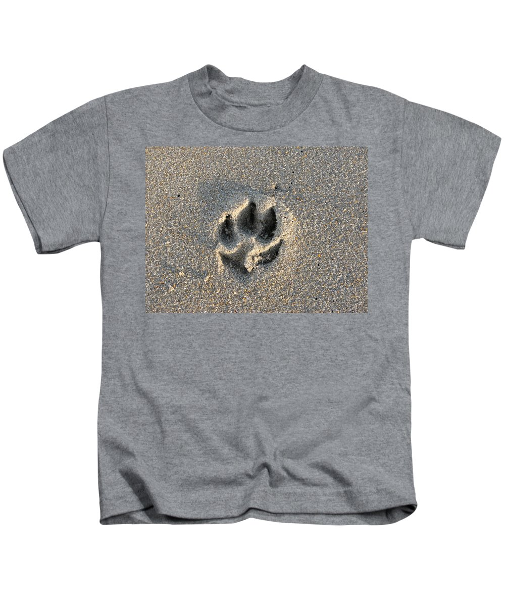 Dog Kids T-Shirt featuring the photograph Pawprint In The Sand by Stacey May