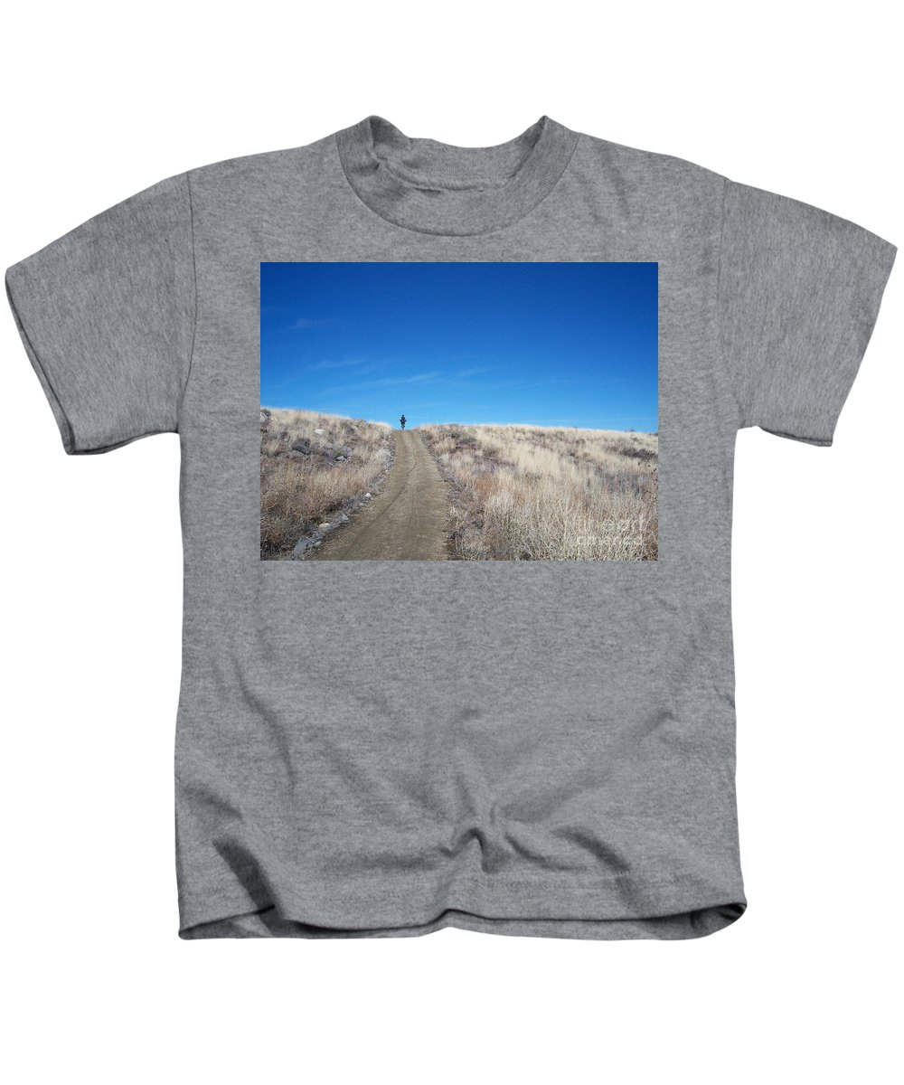 Racing Bike Kids T-Shirt featuring the photograph Racing Over The Horizon by Heather Kirk