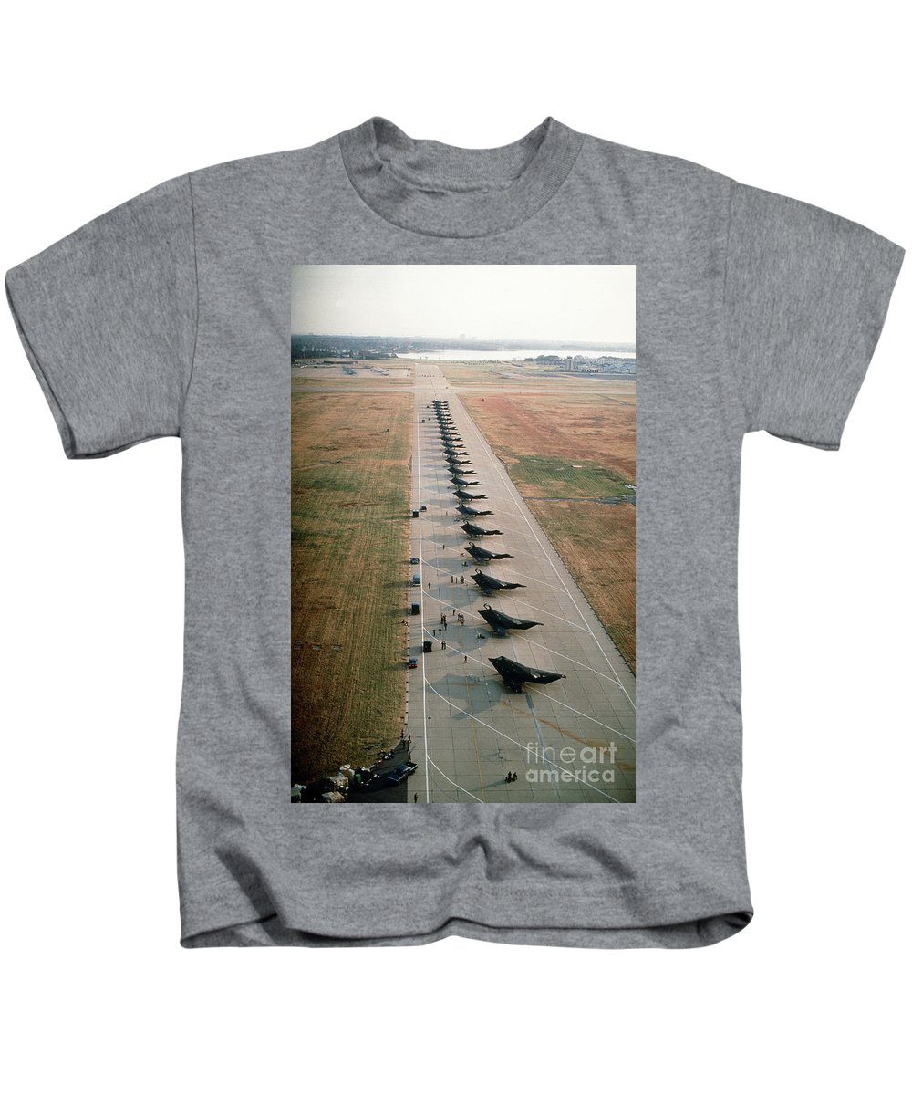 Stealth Fighters 37 Tactical Fighter Wing Kids T-Shirt featuring the photograph Stealth Fighters 37 Tactical Fighter Wing by R Muirhead Art
