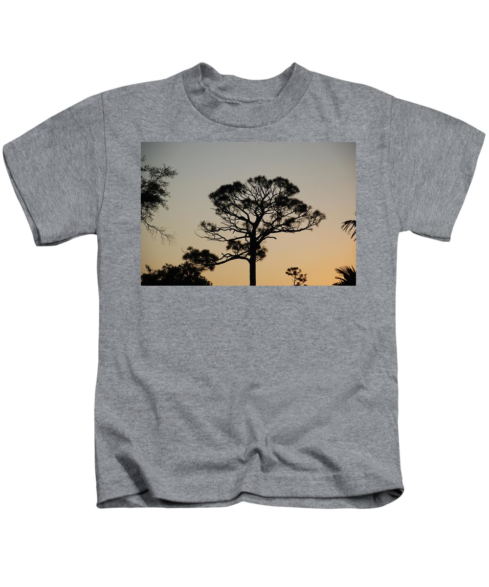 Tree Kids T-Shirt featuring the photograph Sunsetting Thru The Trees by Rob Hans