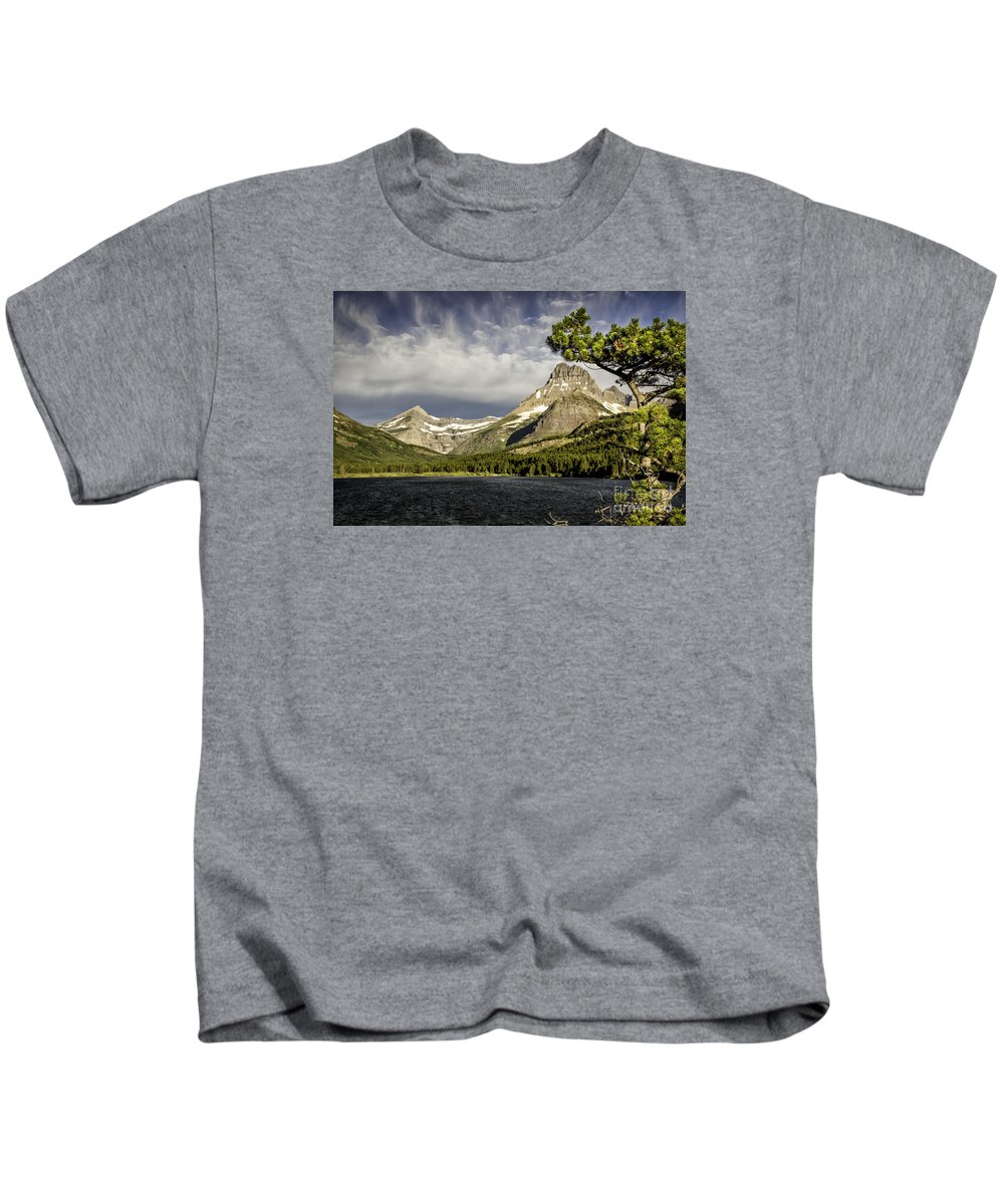 Glacier Kids T-Shirt featuring the photograph Swiftcurrent Lake by Timothy Hacker