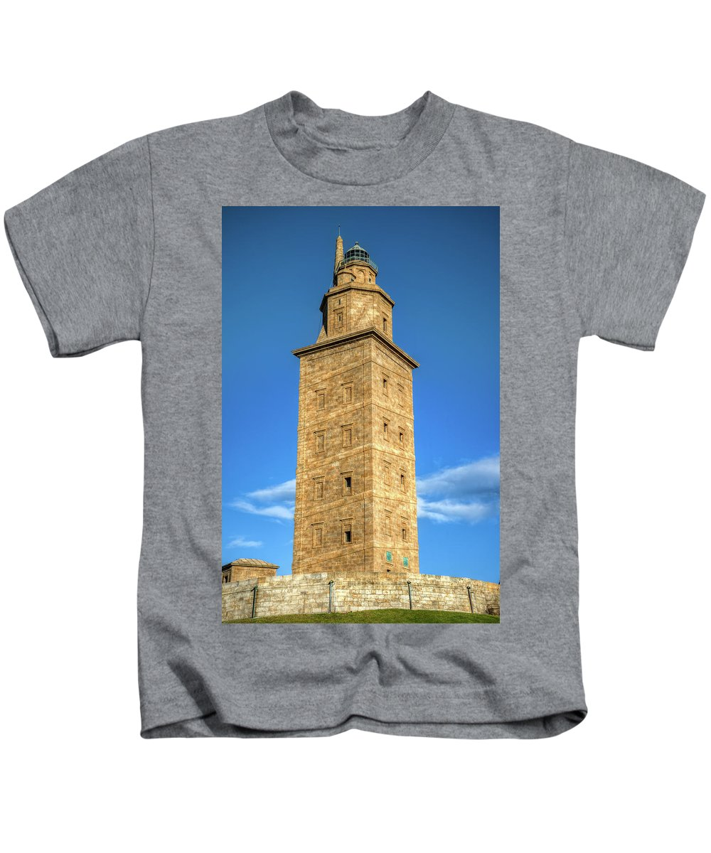 Galicia Kids T-Shirt featuring the photograph The Roman Lighthouse Known As Tower Of Hercules by Luis Vilanova