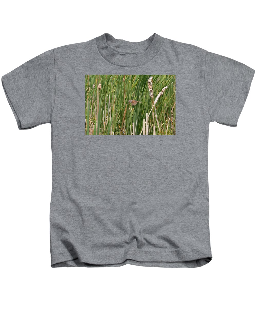 Swamp Sparrow Kids T-Shirt featuring the photograph The Swamp Sparrow In-flight by Asbed Iskedjian