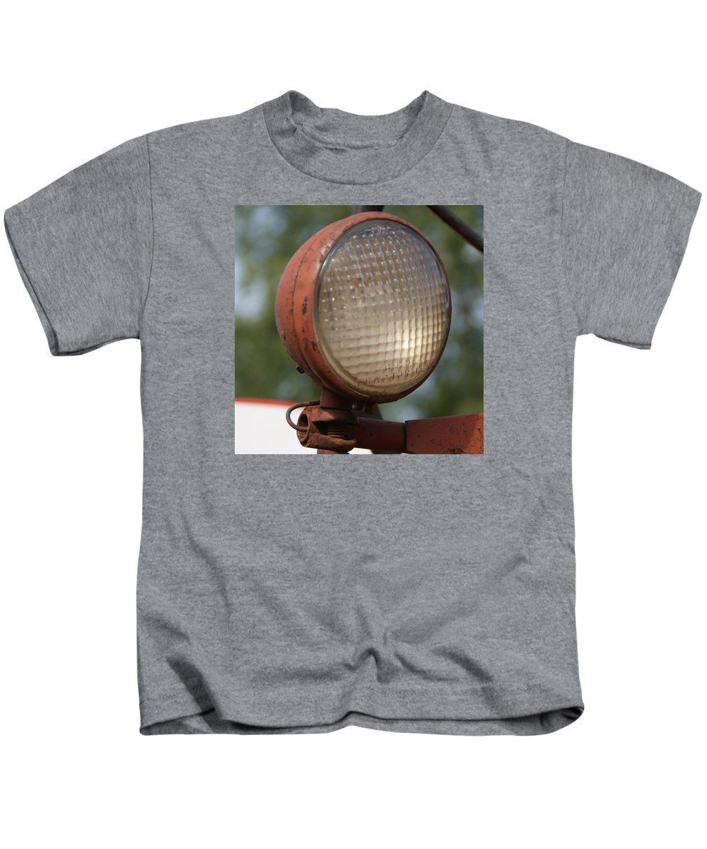Tractor Kids T-Shirt featuring the photograph Tractor light by Toni Berry