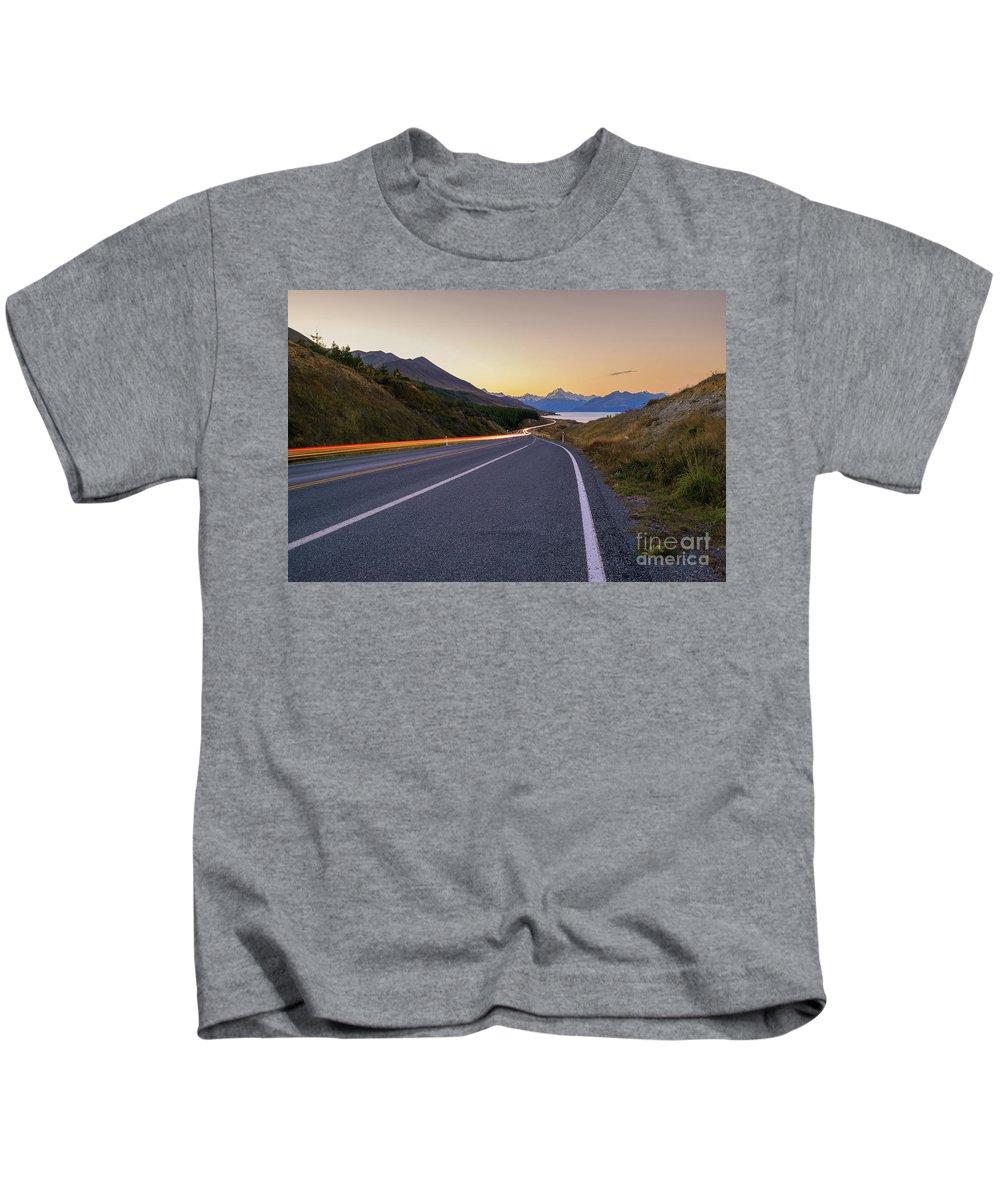 Mount Cook Kids T-Shirt featuring the photograph Trailblazing Towards Aoraki by Kamrul Arifin Mansor