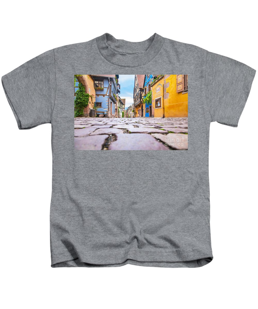 Alsace Kids T-Shirt featuring the photograph half-timbered houses, Riquewihr, Alsace, France  by Marco Arduino
