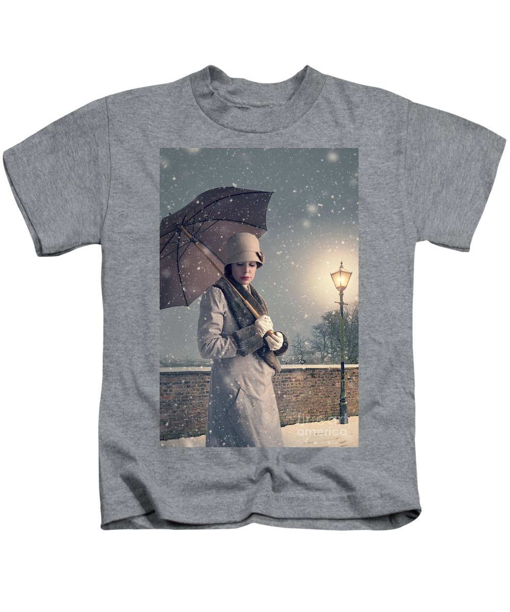 1940's Kids T-Shirt featuring the photograph Vintage Woman With Coat Hat And Umbrella Outside In Snow by Lee Avison