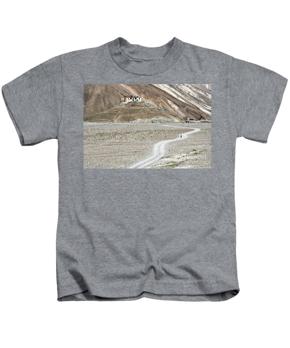 Walking Kids T-Shirt featuring the photograph Walking Alone by Hitendra SINKAR