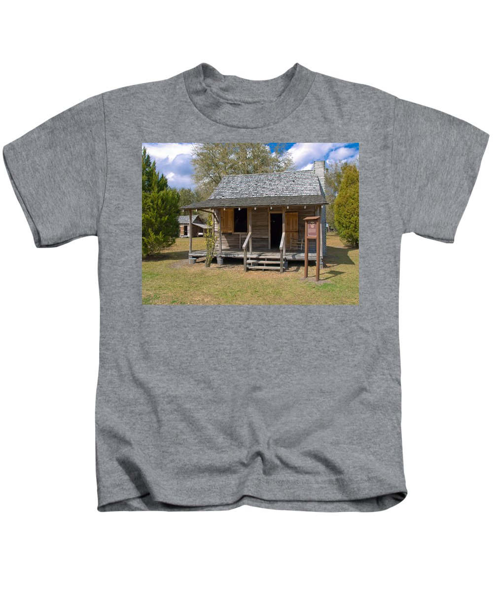 Cabin Kids T-Shirt featuring the photograph Yates Homestead Built In 1893 On Taylor Creek In Central Florida by Allan Hughes