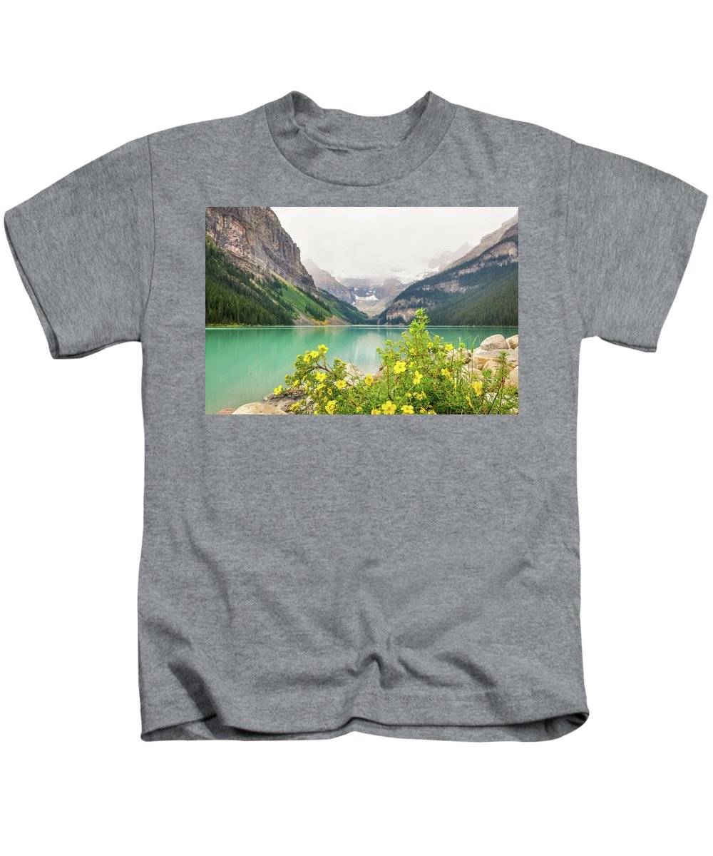 Alberta Kids T-Shirt featuring the photograph Yellow Flowers At Lake Louise by Daniela Constantinescu