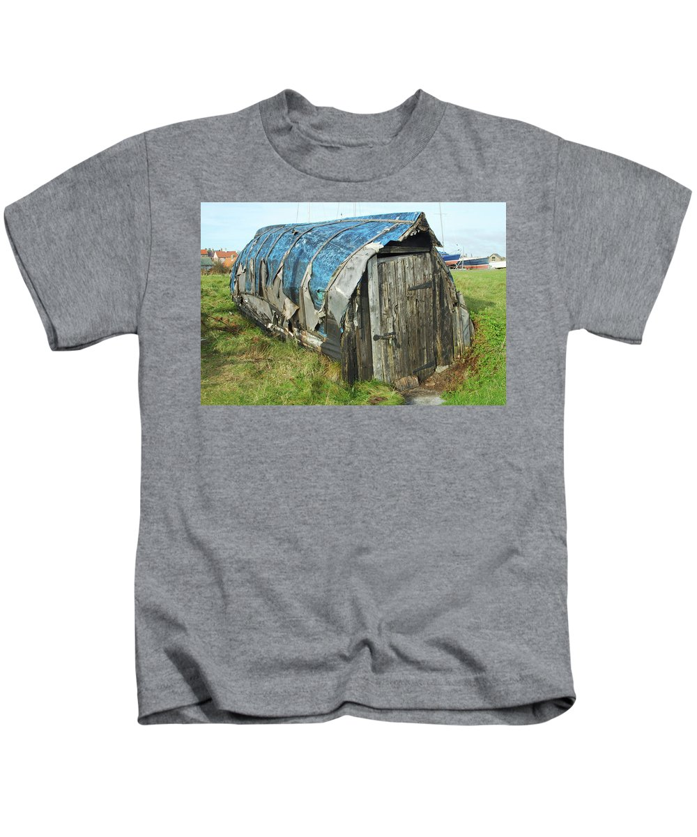 Boat Kids T-Shirt featuring the photograph old boat hut at Lindisfarne island by Victor Lord Denovan
