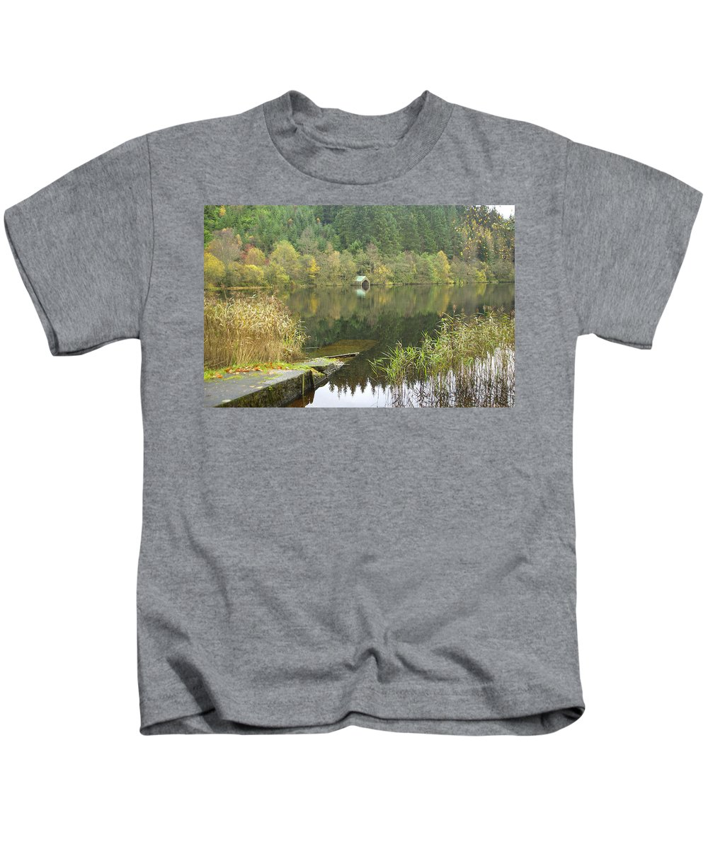 Loch Ard Kids T-Shirt featuring the photograph old boathouse at Loch Ard near Aberfoyle in autumn by Victor Lord Denovan