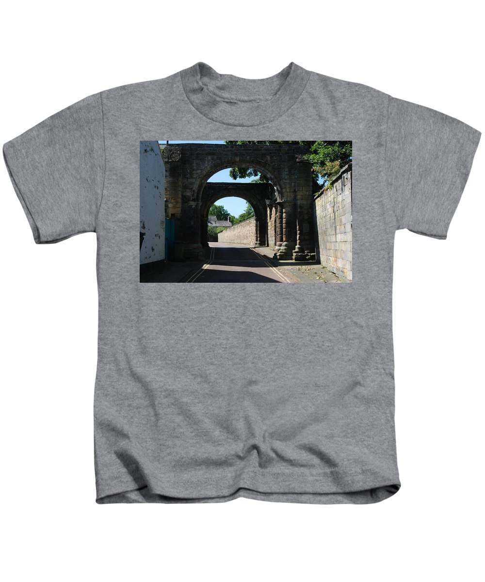 Winding Kids T-Shirt featuring the photograph old historic town gate in Hexham by Victor Lord Denovan