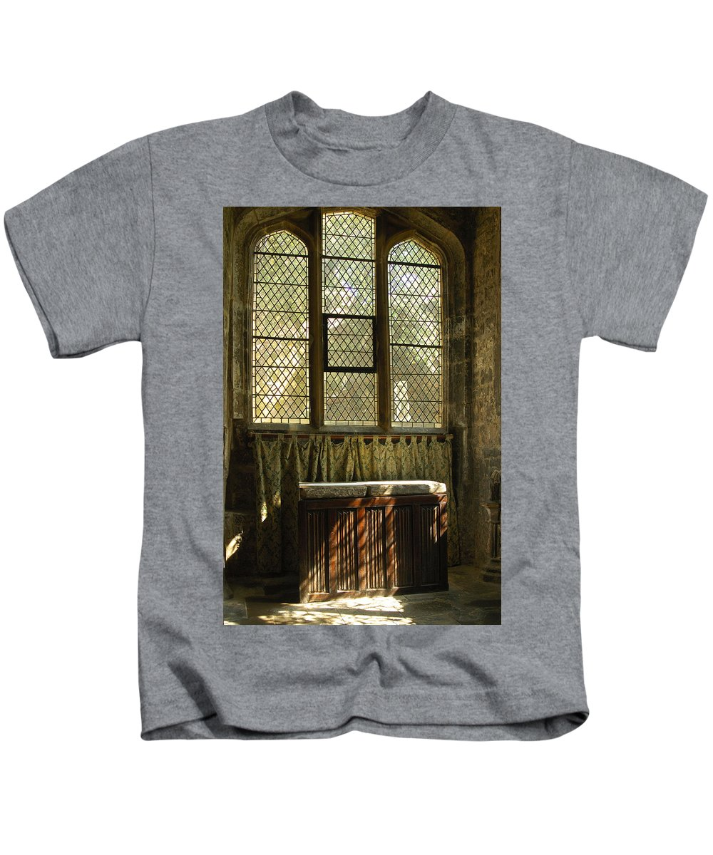 Altar Kids T-Shirt featuring the photograph sunlight on linen fold altar in Trinity church York by Victor Lord Denovan