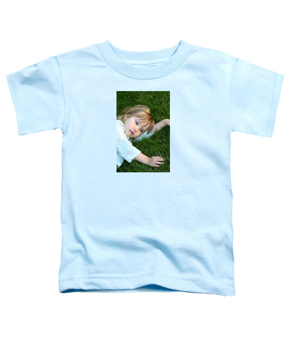 Girl Toddler T-Shirt featuring the photograph Lying In The Grass by Margie Wildblood