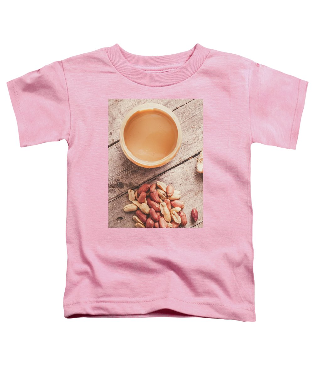 Peanuts Toddler T-Shirt featuring the photograph Peanut Butter Jar With Peanuts On Wooden Surface by Jorgo Photography - Wall Art Gallery