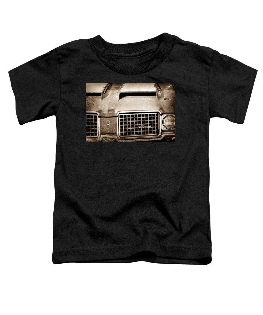 1972 Oldsmobile Grille Emblem Toddler T-Shirt featuring the photograph 1972 Oldsmobile Grille Emblem by Jill Reger