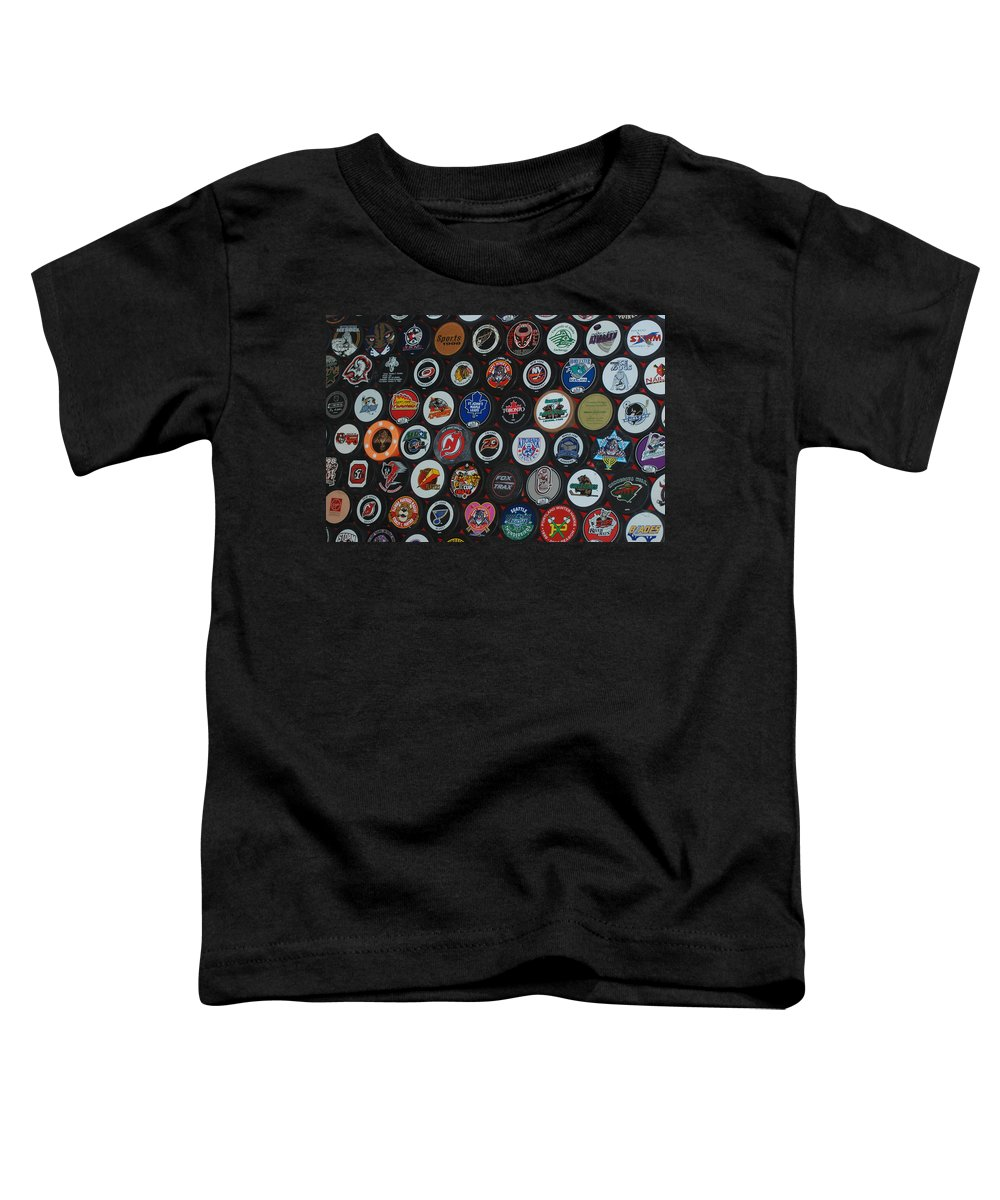 Pop Art Toddler T-Shirt featuring the photograph Hockey Pucks by Rob Hans