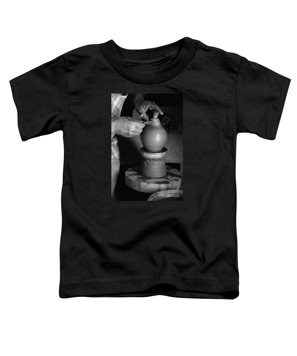 Azores Toddler T-Shirt featuring the photograph Potter At Work by Gaspar Avila