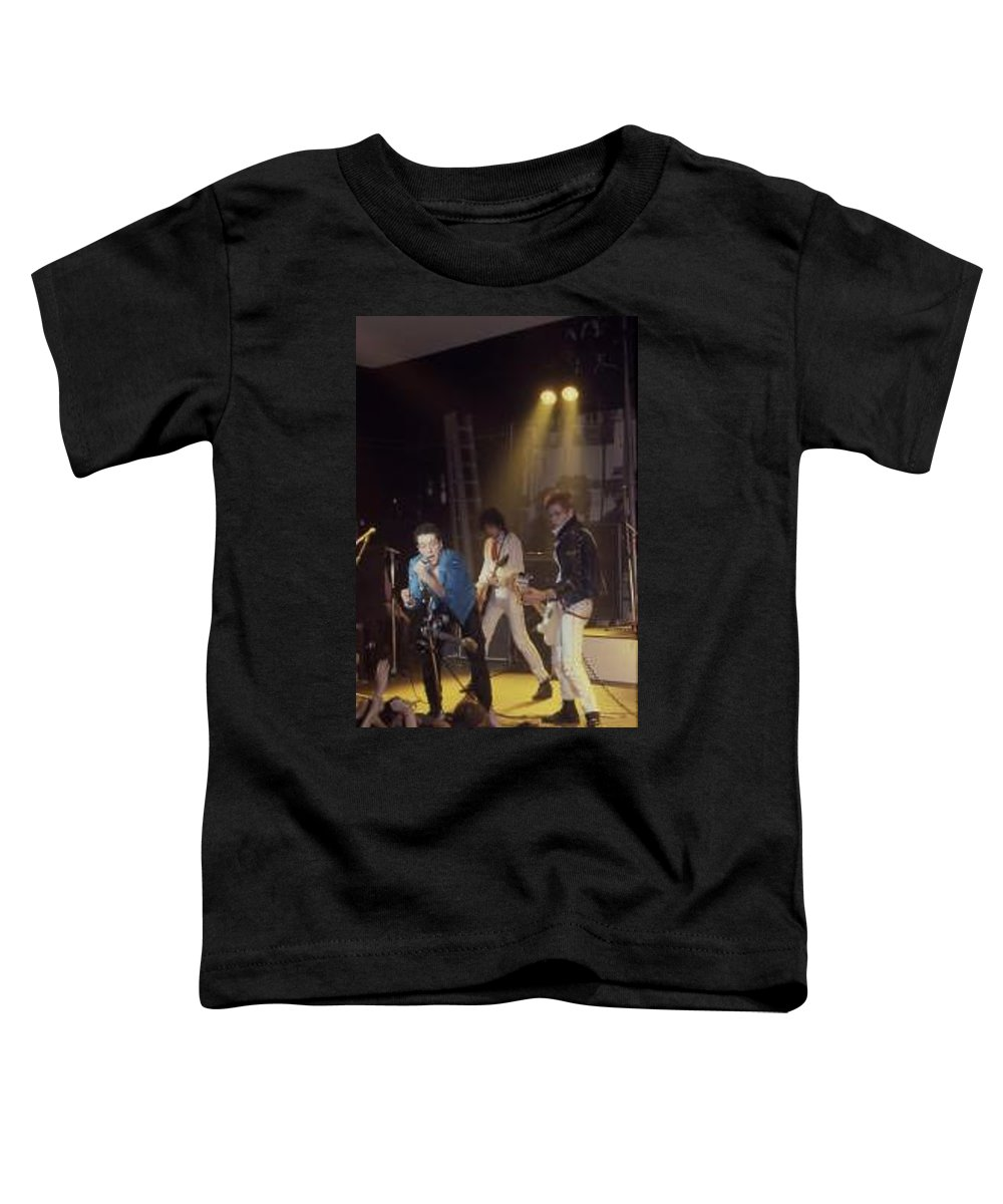 The Clash-london 1978 Photo By Dawn Wirth-copyrighted Toddler T-Shirt featuring the photograph The Clash-london - July 1978 by Dawn Wirth