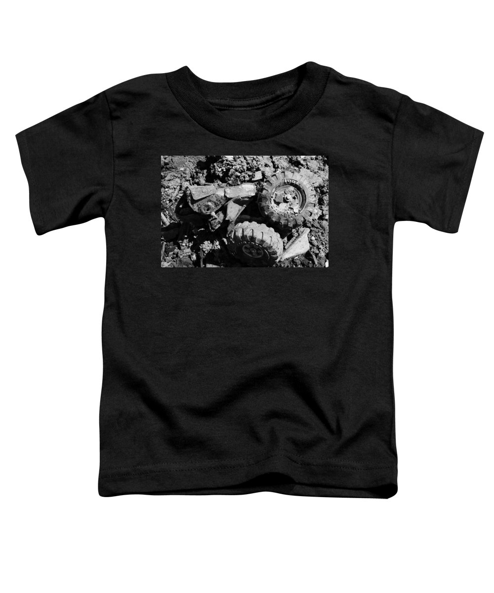 Toy Toddler T-Shirt featuring the photograph Tossed Toy by Angus Hooper Iii