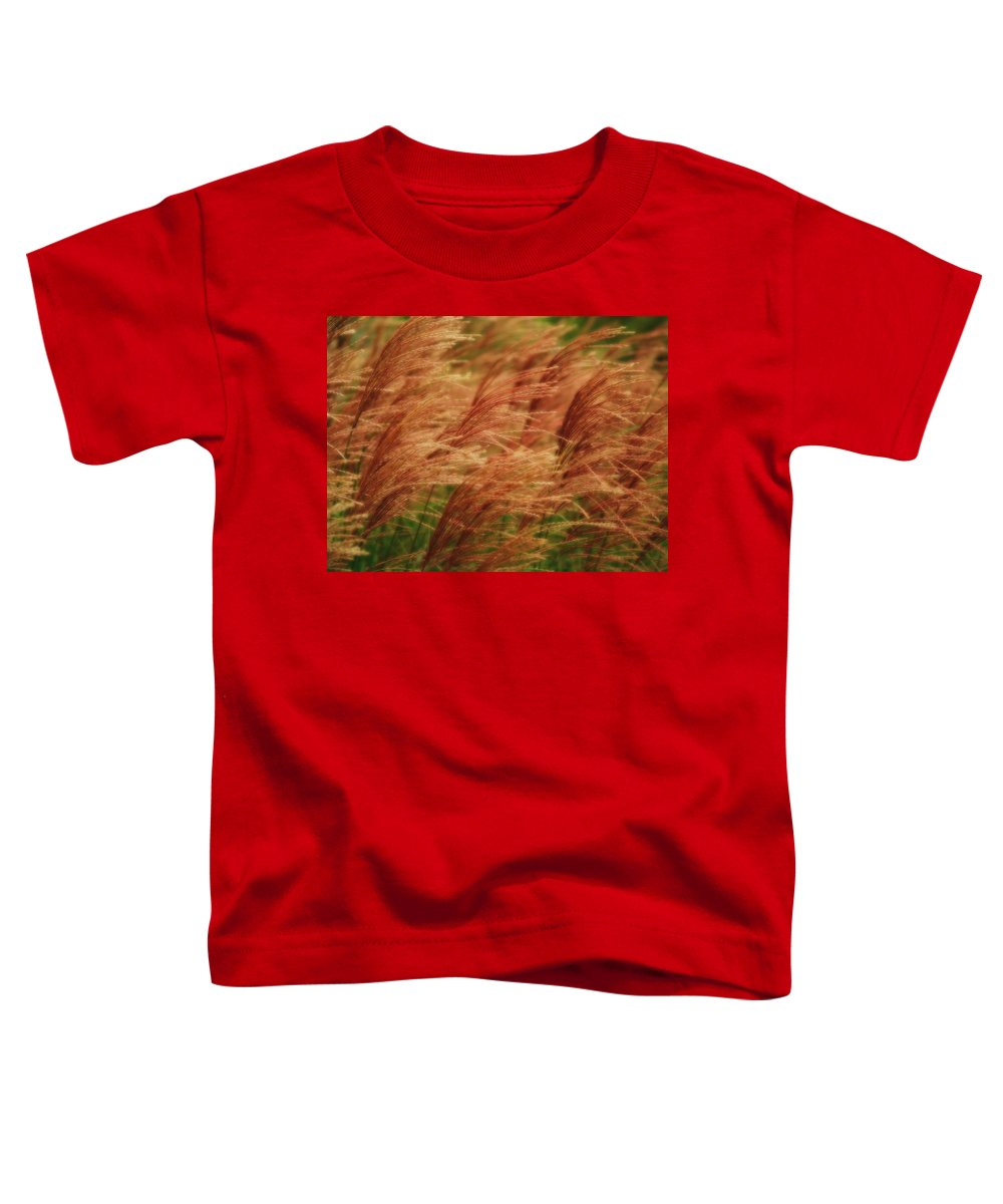 Win Toddler T-Shirt featuring the photograph Blowing In The Wind by Gaby Swanson