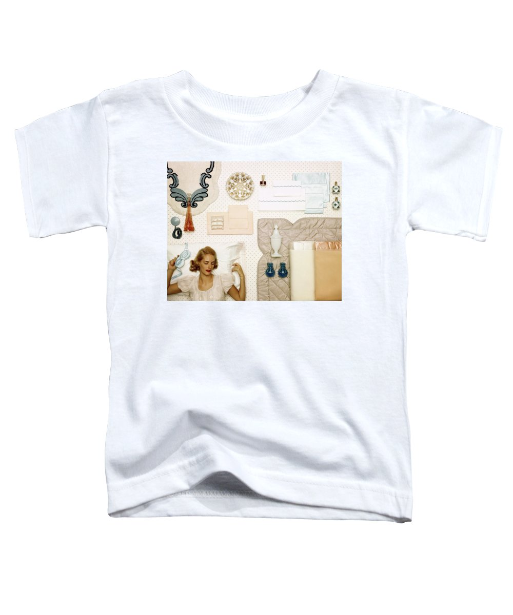 Bedroom Toddler T-Shirt featuring the photograph A Woman Sleeping Next To An Assorted Range by Geoffrey Baker