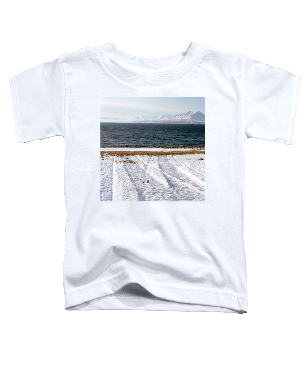 Coast Toddler T-Shirt featuring the photograph The Lyngen Alps And Snowmobile Tracks by Kari Medig
