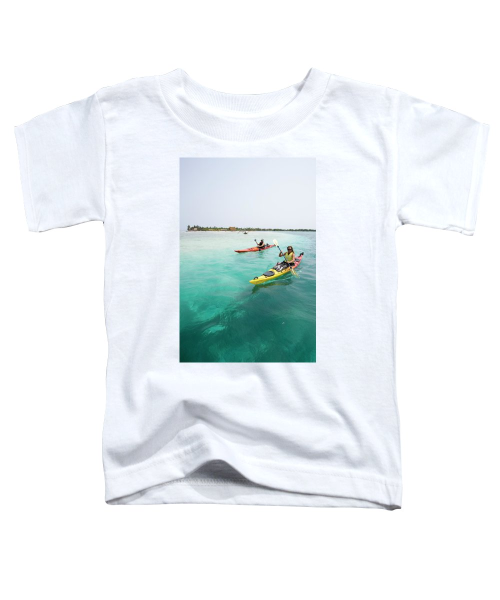 30's Toddler T-Shirt featuring the photograph Young Couple Sea Kayaking by Henry Georgi