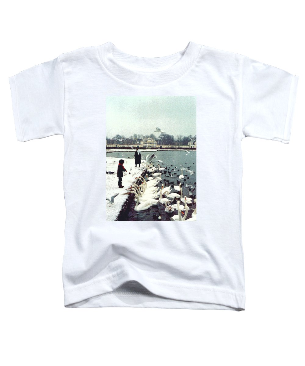 Swans Toddler T-Shirt featuring the photograph Boy Feeding Swans- Germany by Nancy Mueller