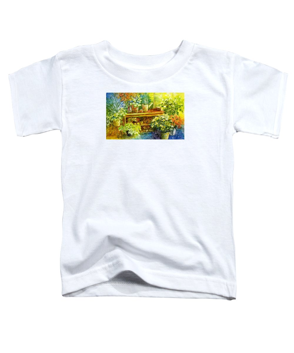 Greenhouse;plants;flowers;gardener;workbench;sprinkling Can;contemporary Toddler T-Shirt featuring the painting Gardener's Joy by Lois Mountz