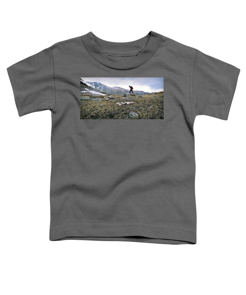 Active Toddler T-Shirt featuring the photograph A Man Hikes Towards Mt. Neva 12,814 Ft by Randall Levensaler