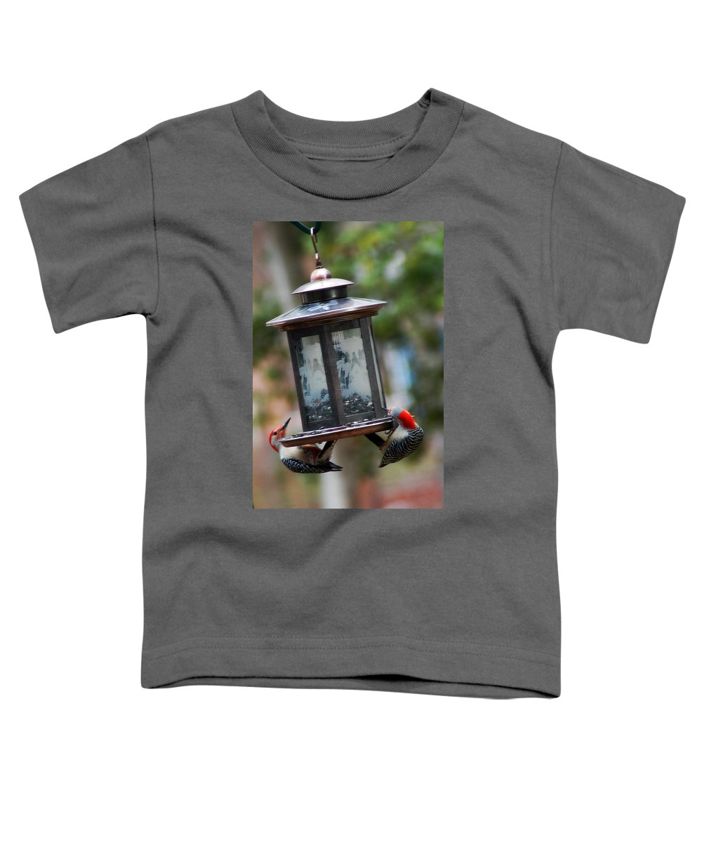 Clay Toddler T-Shirt featuring the photograph Red Head Wood Peckers On Feeder by Clayton Bruster