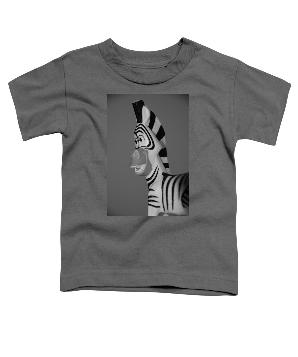 Black And White Toddler T-Shirt featuring the photograph Toy Zebra by Rob Hans