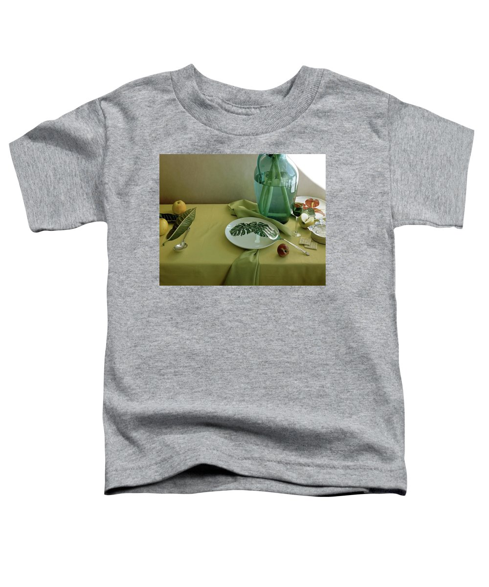 Table Setting Toddler T-Shirt featuring the photograph Plates, Apples And A Vase On A Green Tablecloth by Horst P. Horst