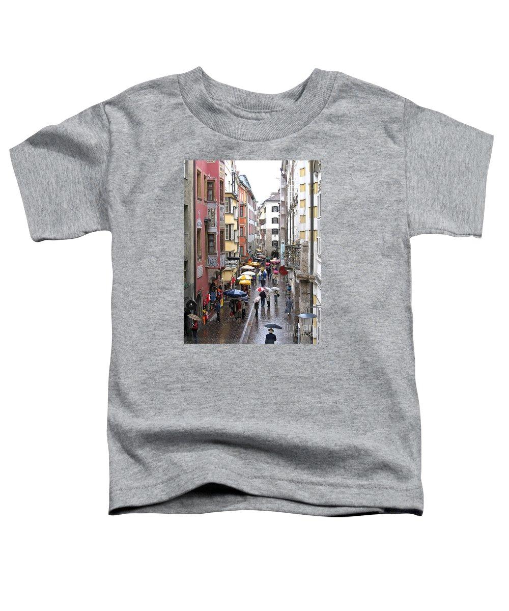 Innsbruck Toddler T-Shirt featuring the photograph Rainy Day Shopping by Ann Horn