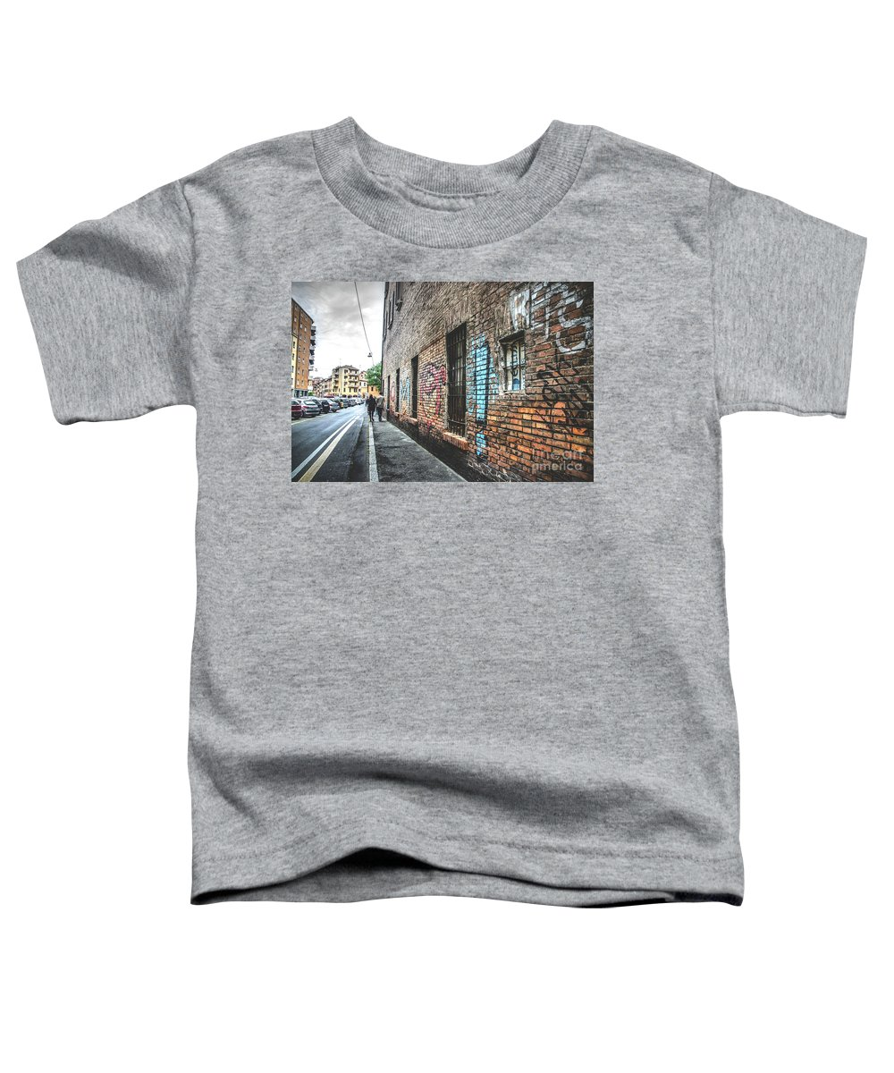 Wall Toddler T-Shirt featuring the photograph Couple Walk In Grunge City Downtown - Bologna by Luca Lorenzelli