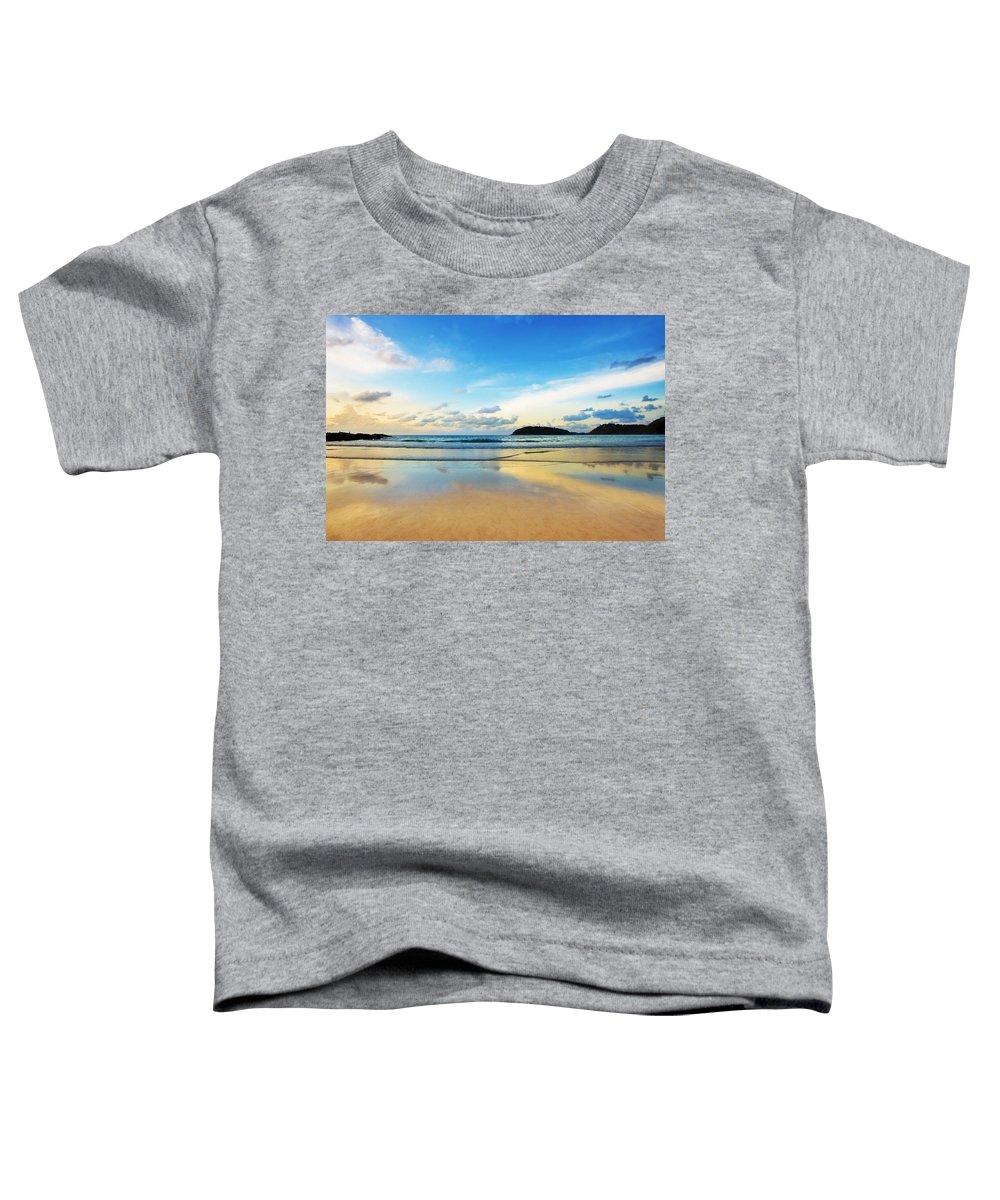 Area Toddler T-Shirt featuring the photograph Dramatic Scene Of Sunset On The Beach by Setsiri Silapasuwanchai