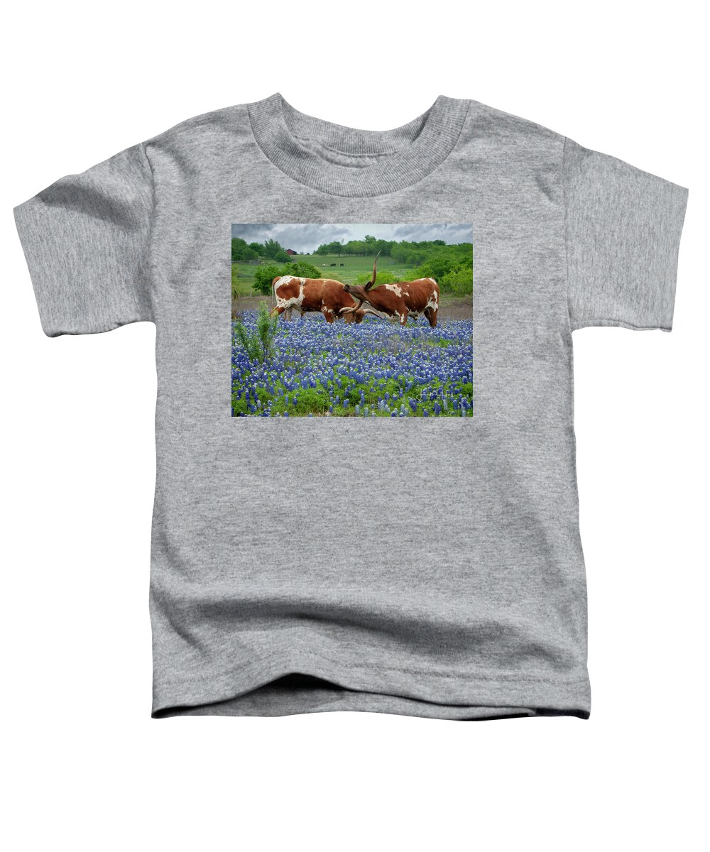 Longhorn Toddler T-Shirt featuring the photograph Playing in the Bluebonnets by Linda Lee Hall
