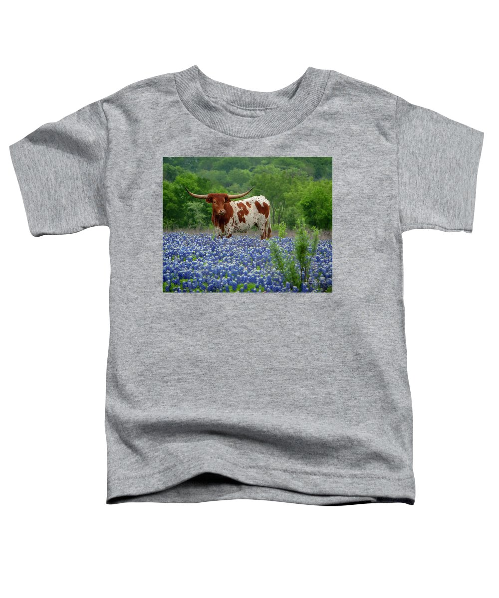Longhorn Toddler T-Shirt featuring the photograph Sprite in the Bluebonnets by Linda Lee Hall