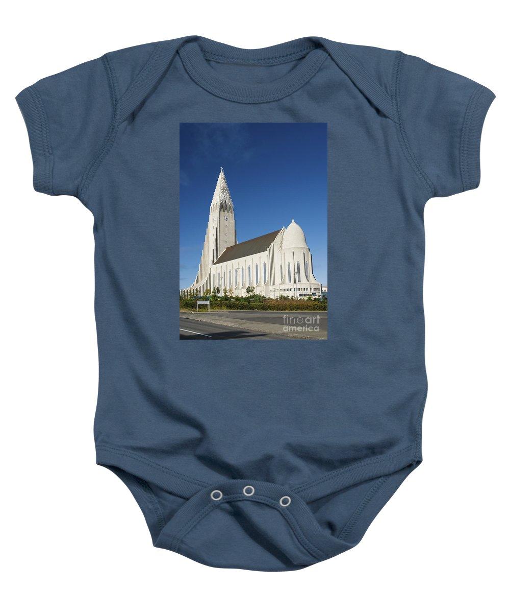 Hallgrimskirkja Baby Onesie featuring the photograph Hallgrimskirkja Church In Reykjavik Iceland by Jacek Malipan