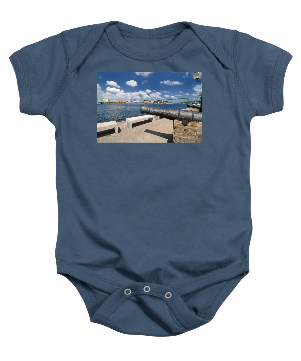 1779 Baby Onesie featuring the photograph Old Cannon And Queen Juliana Bridge Curacao by Amy Cicconi
