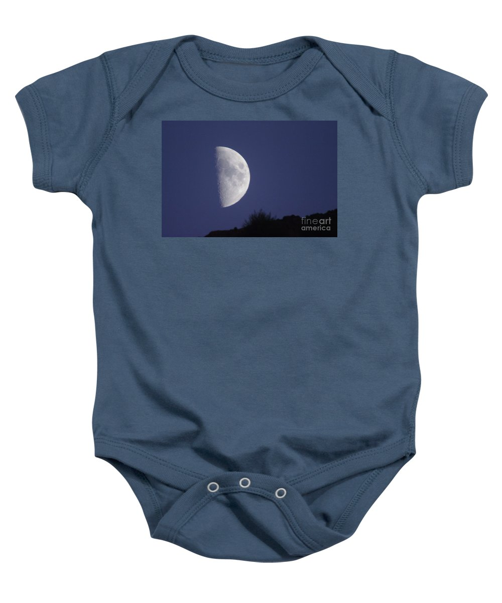 Moon Baby Onesie featuring the photograph The Moon Over A Mountain by Jeff Swan